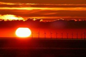 Sunset over Wind Farm off Kent Coast UK.