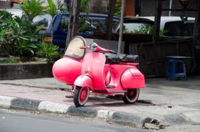 Bright pink vespa in Bali