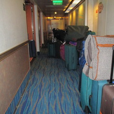 Luggage crammed in hallway outside our door Disembarkation
