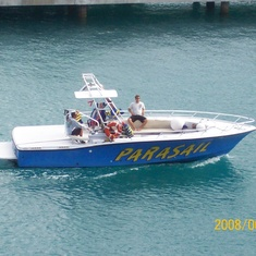 Our parasailing boat arrives.