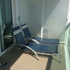 Balcony with sunbeds