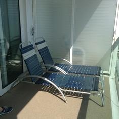 Balcony with sunbeds