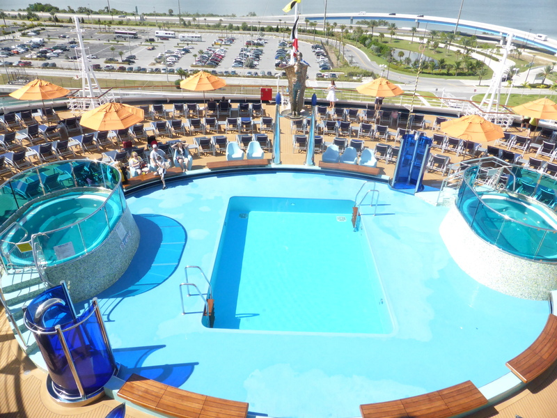 Pool with Port Canaveral in background - Carnival Dream