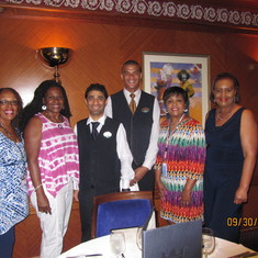 Luesette, Ida, Ethel and Sharon with our dining room waiters Roson and Joel