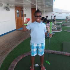 My daughter having fun with putt putt golf