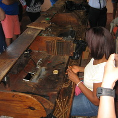 Hand rolling cigars in a cigar shop in the DR