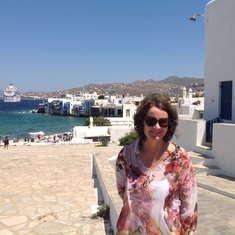 Catherine with the ship in the background at Mykonos.