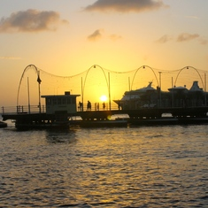 Our ship and Queen Emma Pontoon Bridge at sunset in Curacao