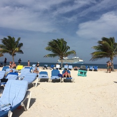 Beautiful Coco Cay. The ship out at sea.