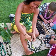 Making bracelets at the lu'au in Maui