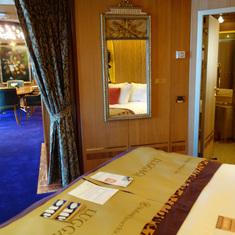 View from Bedroom towards Bathroom Door and Dining Room, Pinnacle Suite 7001
