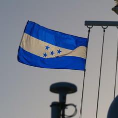 Coxen Hole, Roatan, Bay Islands, Honduras - Honduran Flag at departure time from Vibe Beach Club on Deck 17 Forward