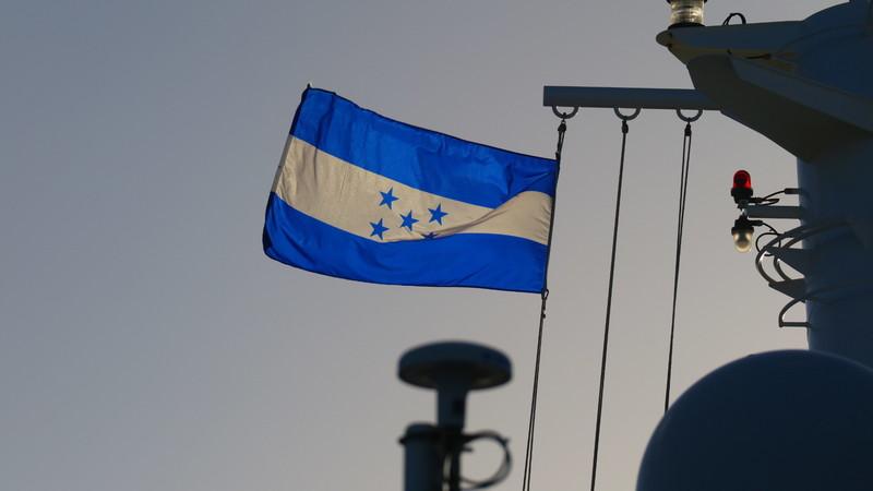 Coxen Hole, Roatan, Bay Islands, Honduras - Honduran Flag at departure time from Vibe Beach Club on Deck 17 Forward