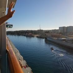 Waving BYE-BYE from our balcony