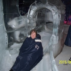 Sliding down the ice slide at Magic Ice ice bar.