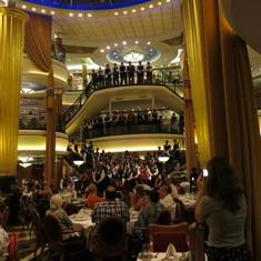 The wait staff on the grand staircase in the dining room