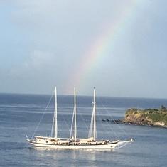 Rainbow over sailing ship