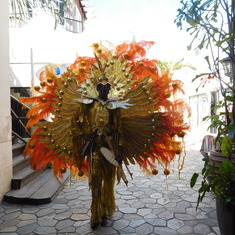 A guy dressed in a Junkanoo outfit