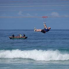 Hatian Fisherman watch zipliners on Labadee