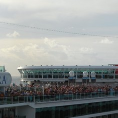 When they left, the passengers of the Azura were on deck waving British flags