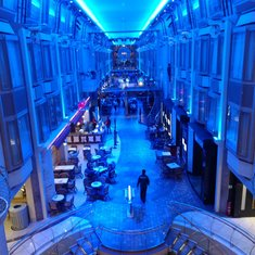 Promenade deck lit up blue at night