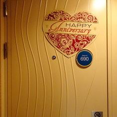 Happy Anniversary sign on cabin door