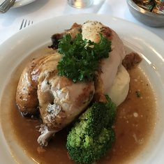 Gluten-free rotisserie chicken with mashed potatoes and broccoli - in Summer Palace main dining room