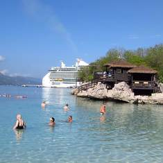 Freedom of the Seas docked in Labadee - from private cabana over the water