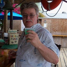 Grand Turk Island - His free shot of rum in a pretty colored drink.