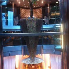 a mosaic planter, the centerpiece between the glass elevators