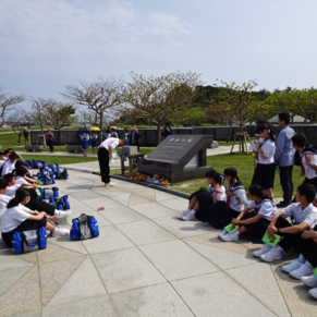 School children pay respect to their war dead at Okinawa beach.