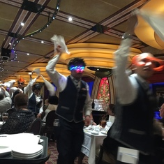 Waiters dancing in the aisles