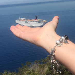 My wife holding the Carnival #Imaginaion in her hand on Catalina Island, while rocking her favorite Bella Perlina Charm Bracelet...