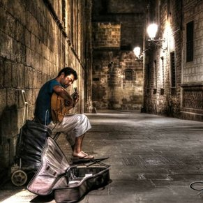 Flamenco guitarist Alvaro Concha playing in 2013 in the Gothic quarter early morning.
