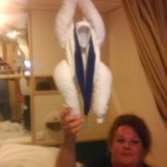 Me with our towel monkey- with my husbands award
