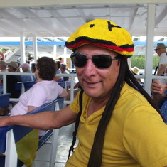 Cococay (Cruiseline's Private Island) - Husband with dreadlocks hat tender back to ship