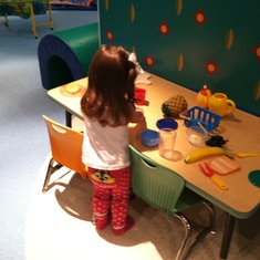 "My niece playing in the ""It's a Small World"" playroom."