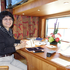Wife at Desk with Window Overlooking Balcony on Pinnacle Suite, Cabin 7001