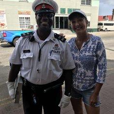 Kim making Nice-Nice to avoid a jaywalking ticket!