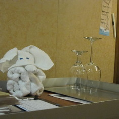 Mini towel elephant on cleaning cart.