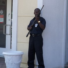 A guard at the bank. If you zoom in, you can see the mean look on his face.