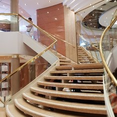 Reception stairs on deck 5 leading up to Coffee Corner on deck 6
