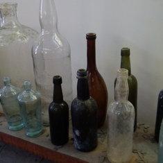 Belize City, Belize - The little leader lady labeler (say that five times fast) slaps 'em on rum bottles.