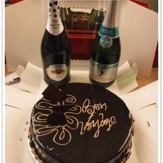Bon Voyage cake we ordered for our group. The 2 bottles of bubbly we brought on.