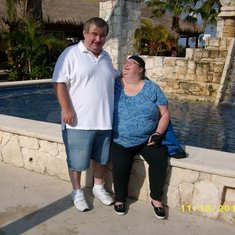 Cozumel, Mexico - This is in front of a mayan look fountain in Cozumel in front of the shops.