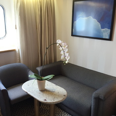 Seating area. Can be set for in-suite dining.
