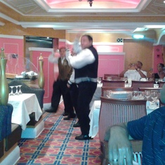 The dining staff performing their nightly dance.