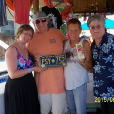 Grand Turk Island - Owners of Jack's Shack. They collect license plates, cheese & dark roast coffee.