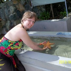 Holding a starfish at Coral World.