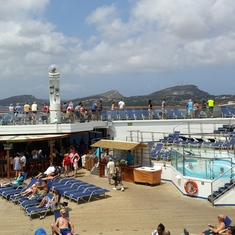 Lido Deck on Conquest with Blue Iguana in background